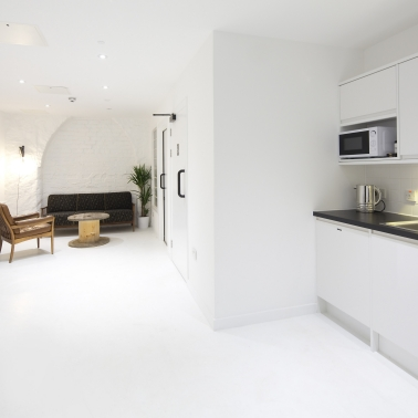 Sika ComfortFloor® white floor in completely white interior of home kitchen